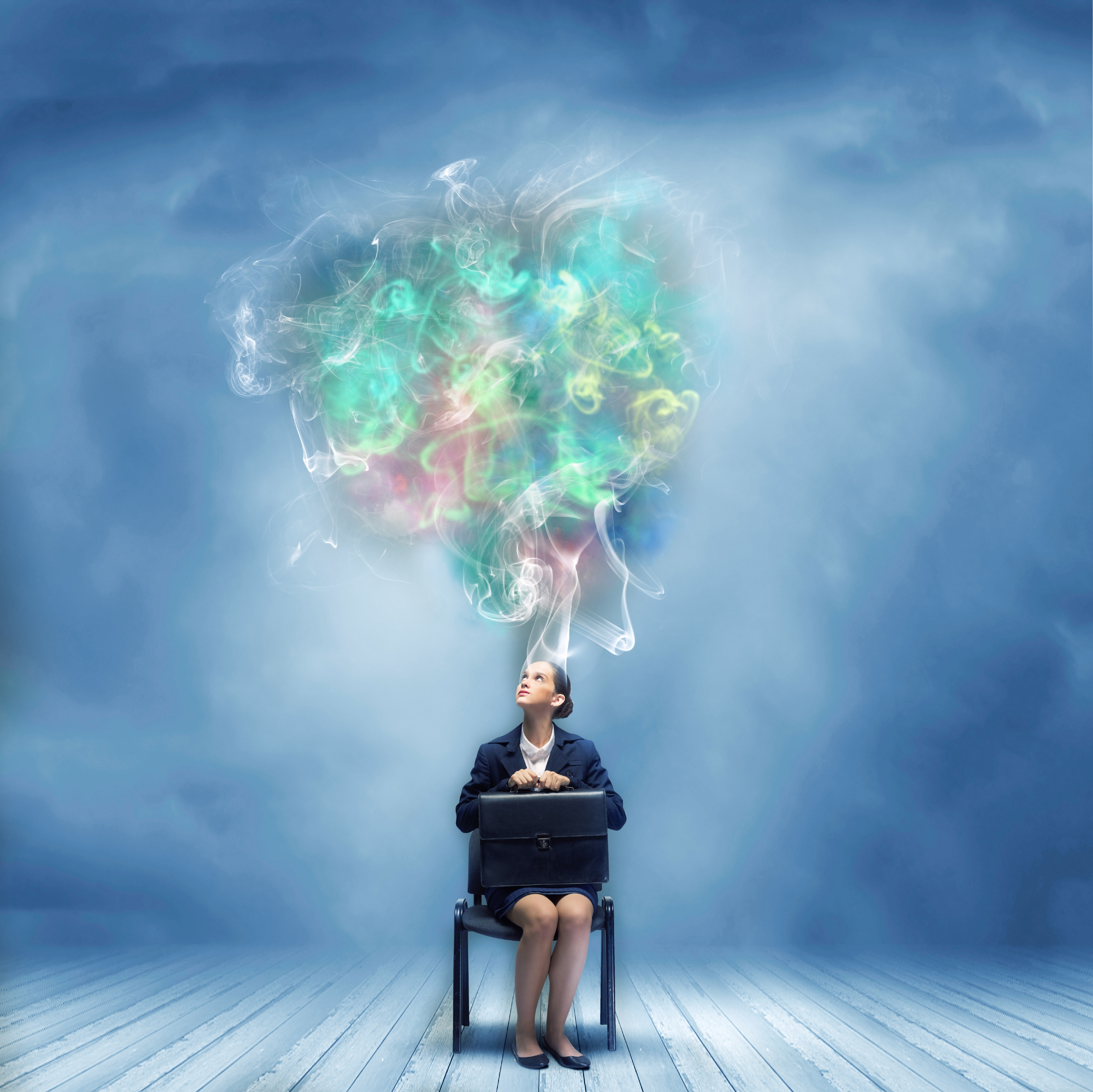 Business woman on chair with colourful streams of thought above