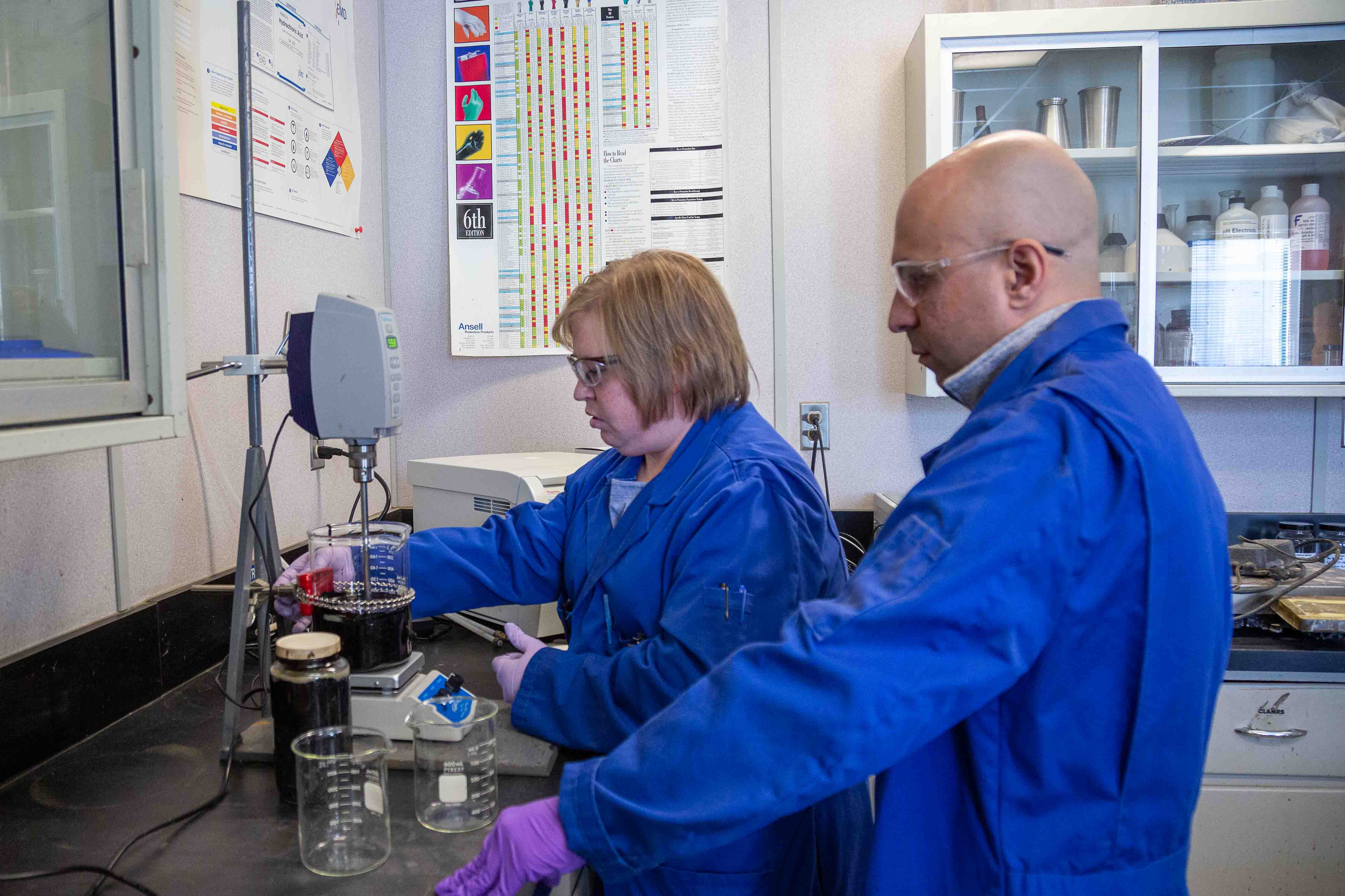 two research engineers work on development of an active clay analyzer