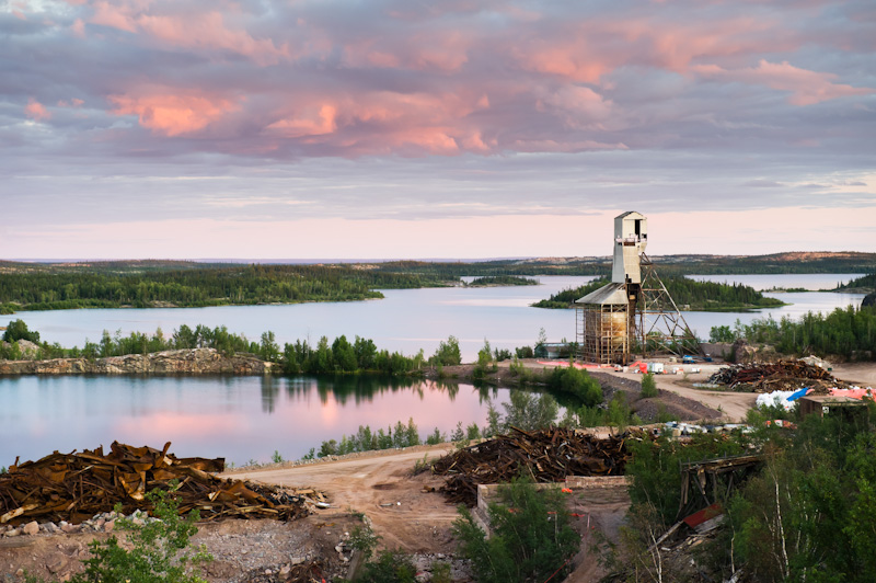 gunnar mine site and headframe against sunset