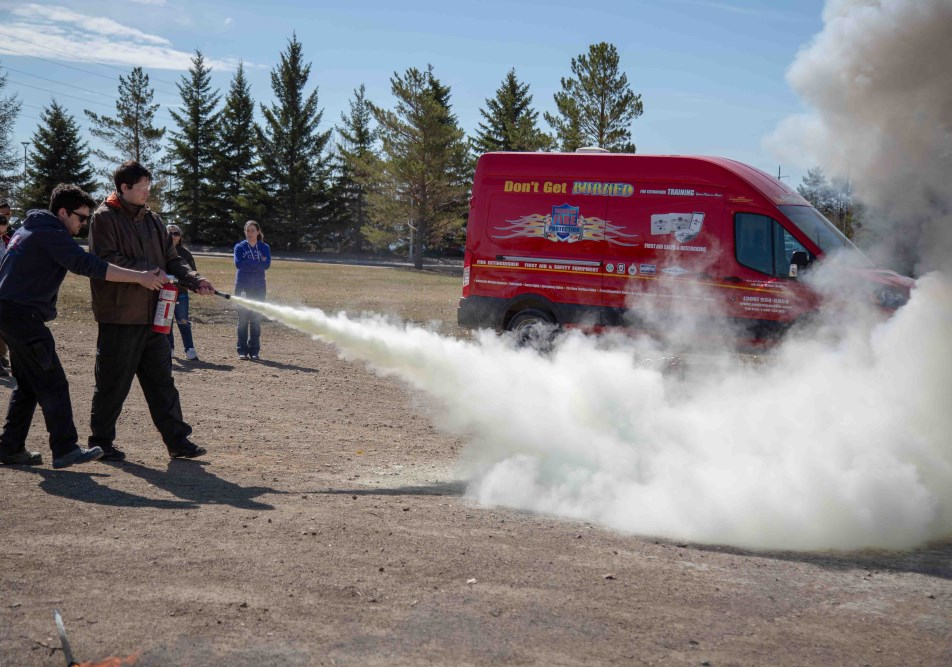 src employees in fire extinguisher training as part of naosh week