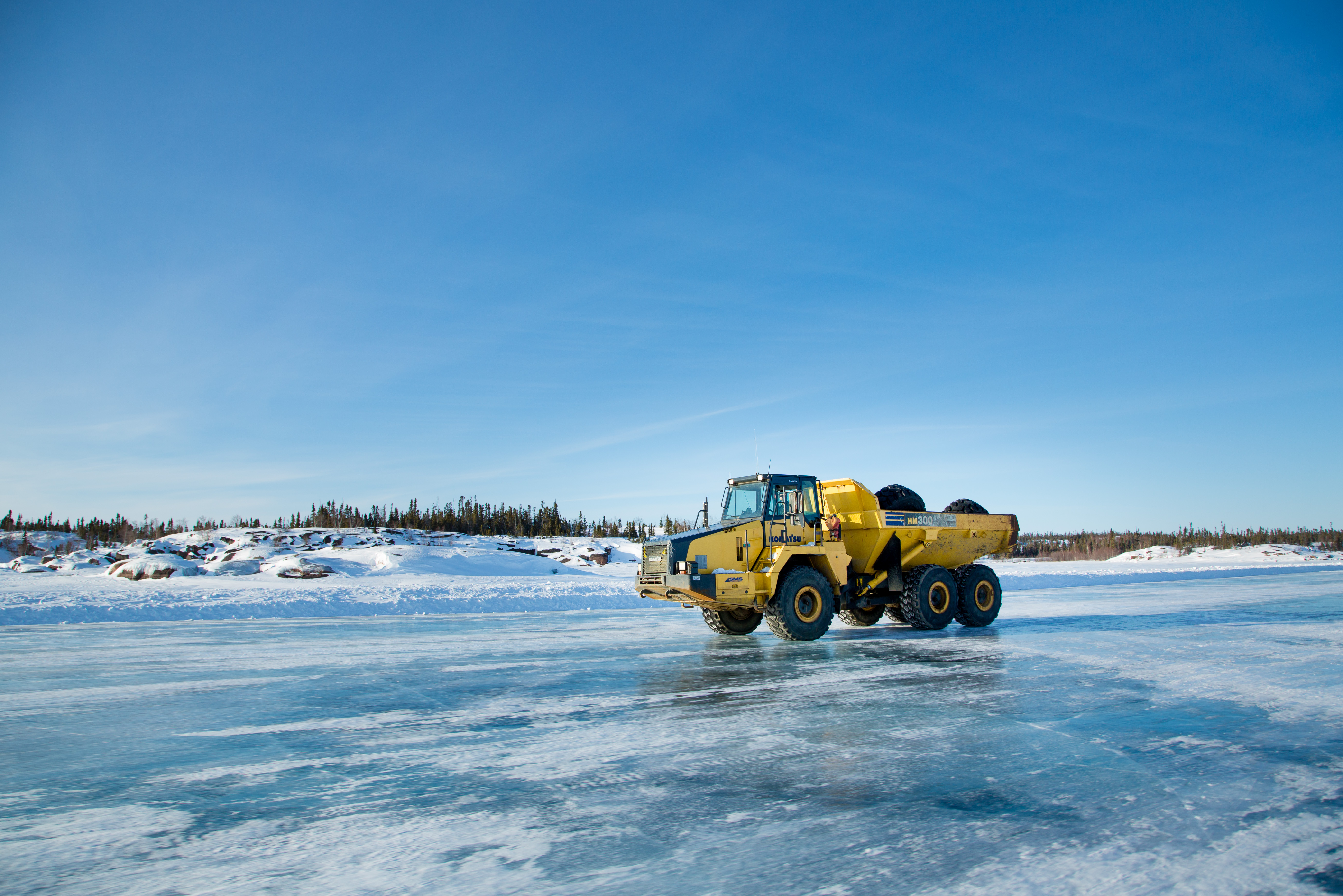 heavy equipment truck driving on ice