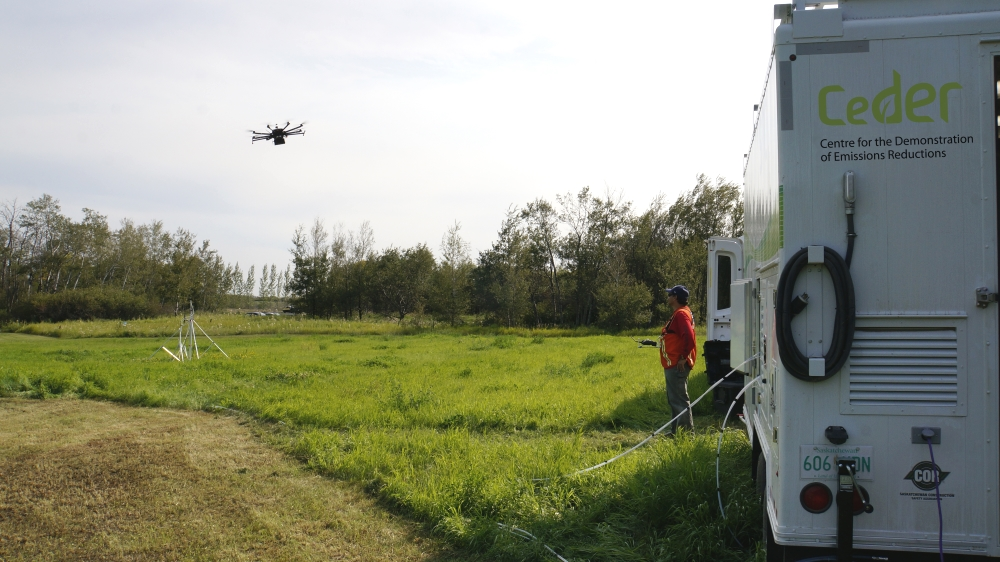 src drone flies beside ceder trailer for gas detection