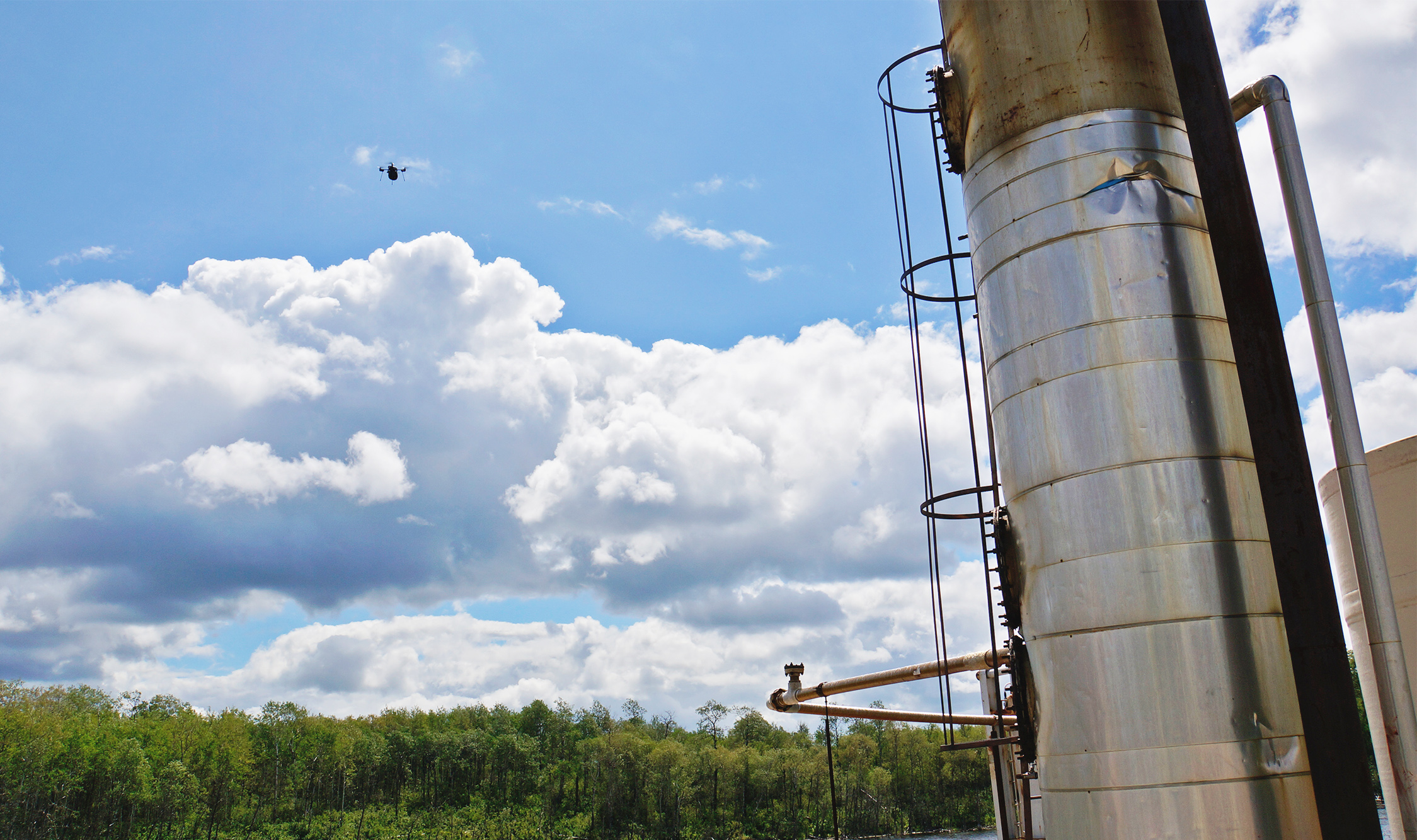 src uav flying around a work site sampling air quality