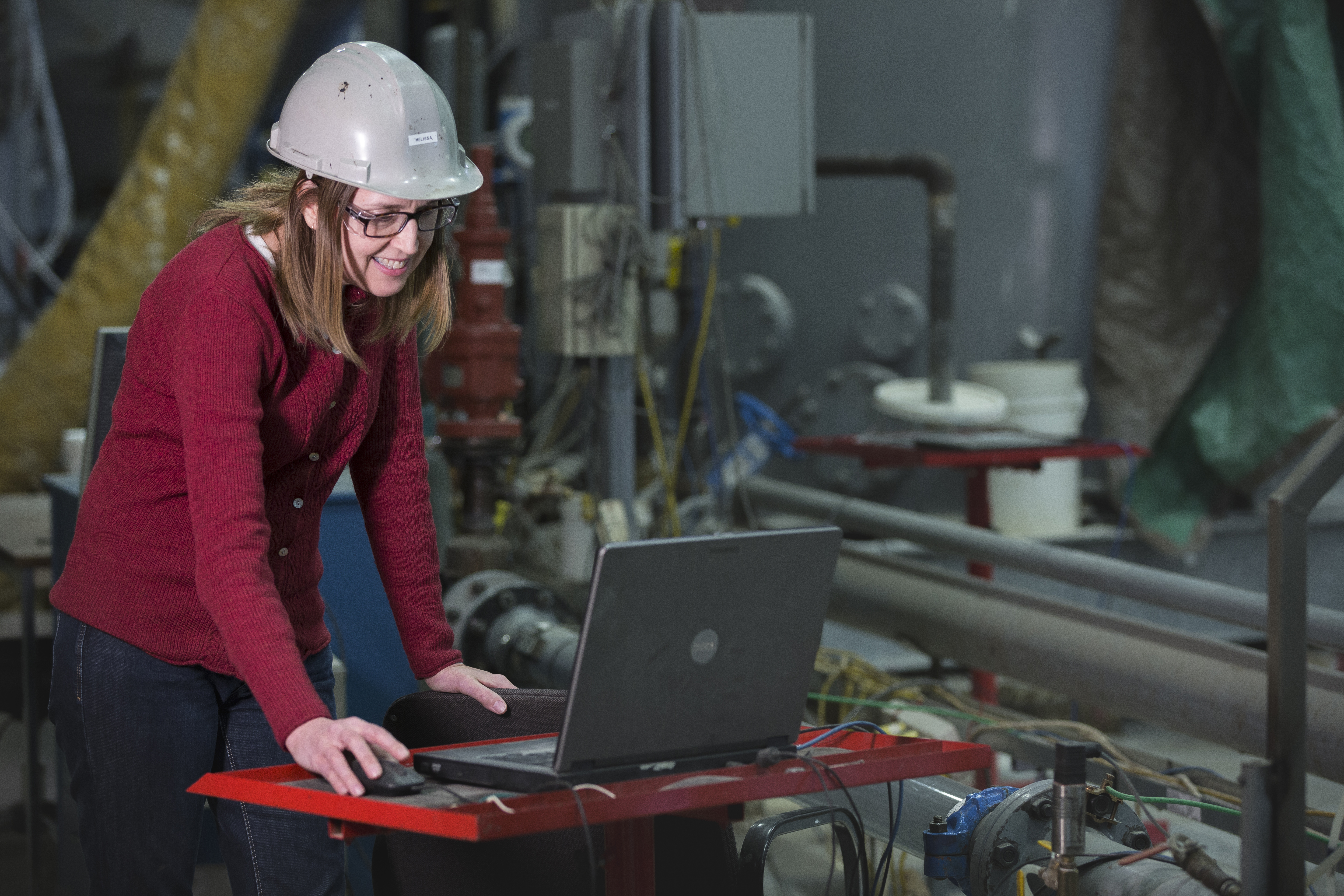 female engineer working at computer in lab