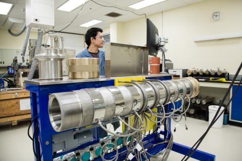 SRC engineer with dual-permeability core flood apparatus in SRC lab
