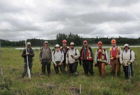 Environmental workers stand in wetland