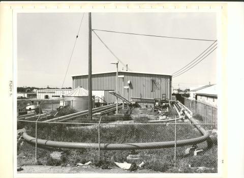 black and white photo of pipe loop and building