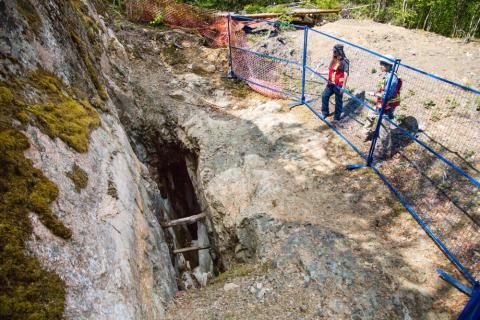 two src environmental remediation experts examine abandoned mine opening