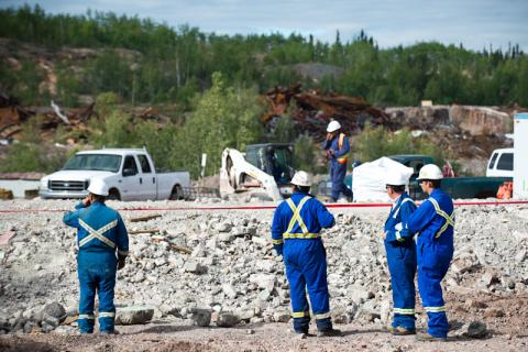 Workers in safety gear at mine site