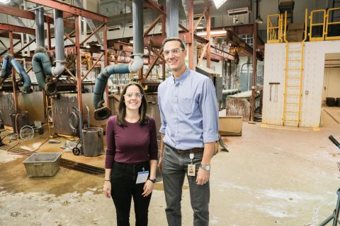 Saskatchewanderer and lab supervisor stand together in front of machinery