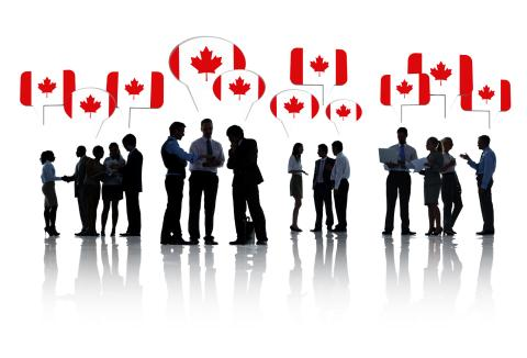 Group Of Business People Talking And Discussing Canada