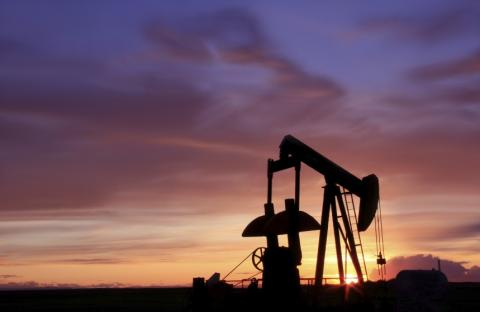 pumpjack against a purple sunset