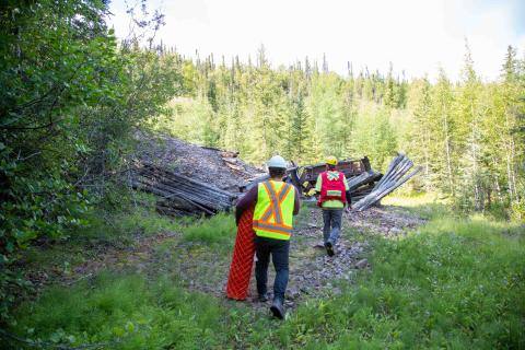 two remediation specialists install fencing at an abandoned mine site