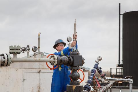 Engineer checks well-head at a post-chops site
