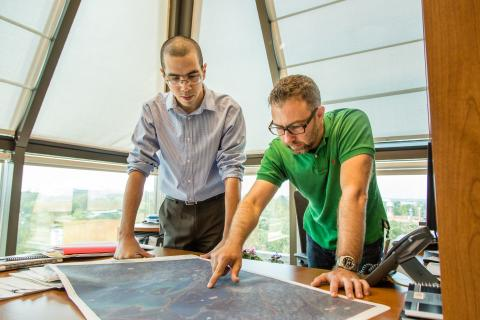 two employees looking at a map