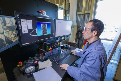 src research engineer works at computer on tight oil research