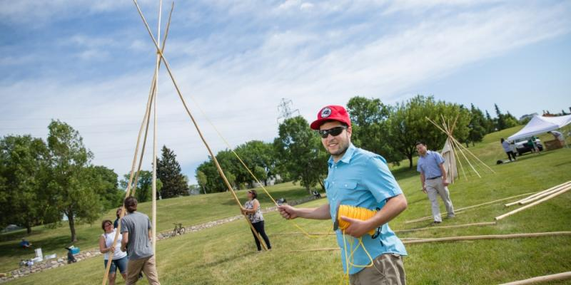 src students raise a tipi on national aboriginal day