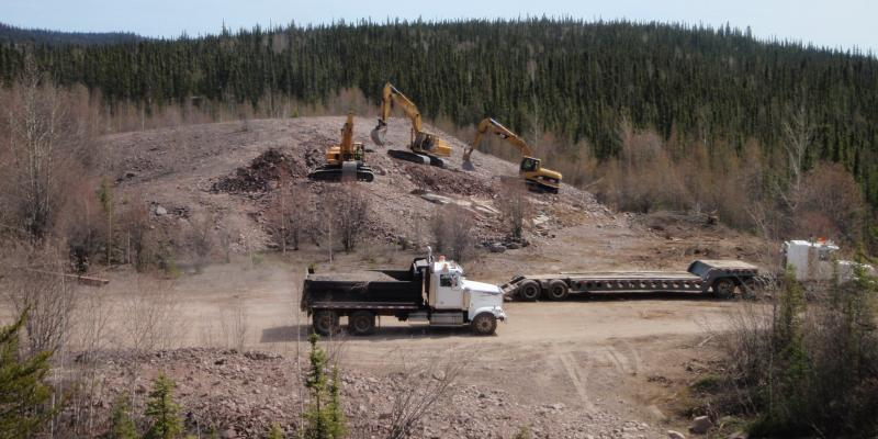 Excavators were used to bury steel and concrete in waste rock adjacent to the Cenex uranium mine, near Uranium City, Sask.