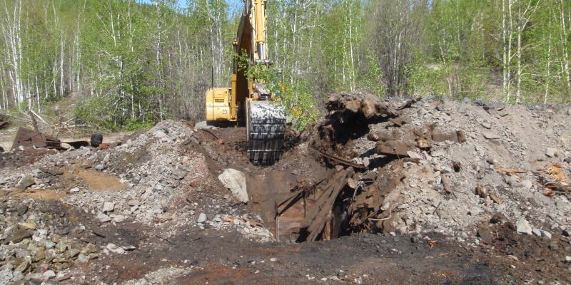 Clearing of the historical closure of the shaft at Nesbitt Labine, Eagle Mine for design of long-term closure