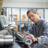 research engineer works on custom equipment