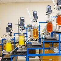 rare earths lab with orange glass containers