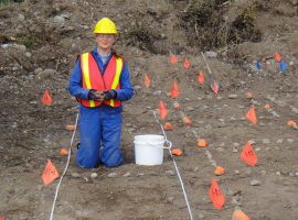 src ecology specialist works on revegetation activities at remediated site