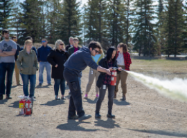 src employees in fire extinguisher training